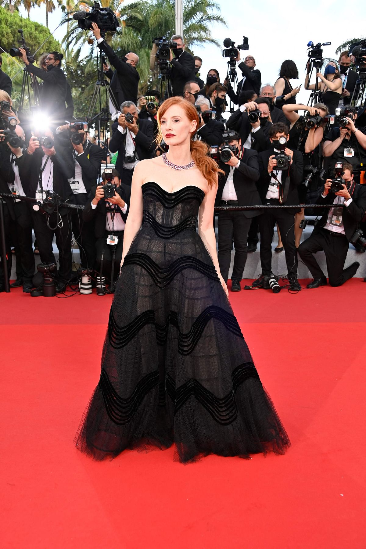 """US actress Jessica Chastain arrives for the opening ceremony and the screening of the film """"Annette"""" at the 74th edition of the Cannes Film Festival in Cannes, southern France, on July 6, 2021. (Photo by John MACDOUGALL / AFP)"""