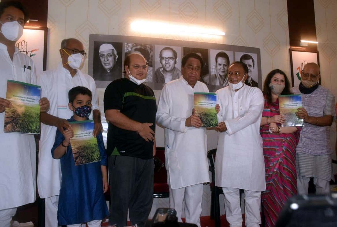 Congress leader and former chief minister of Madhya Pradesh Kamal Nath releasing a book on environment by Laxman Singh in Bhopal on Monday.