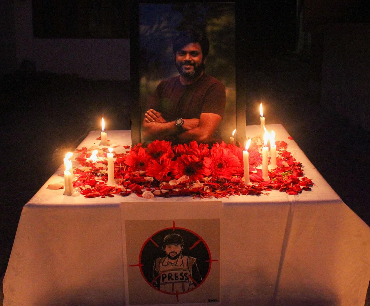 Candles are placed by journalists next to the portrait of Indian photojournalist Danish Siddiqui as a tribute inside the Kashmir Press Club in Srinagar, Jammu & Kashmir on July 18, 2021.