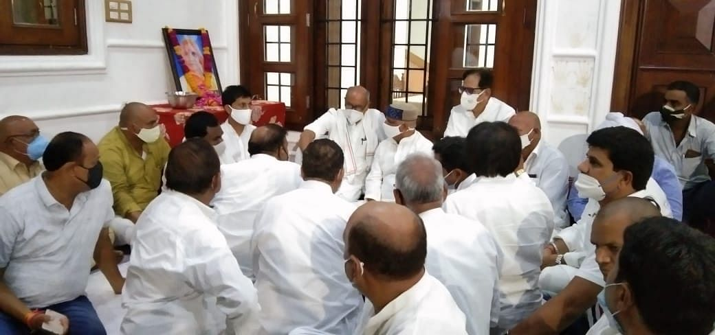 Former chief minister during condolence visit in Dhar on Monday