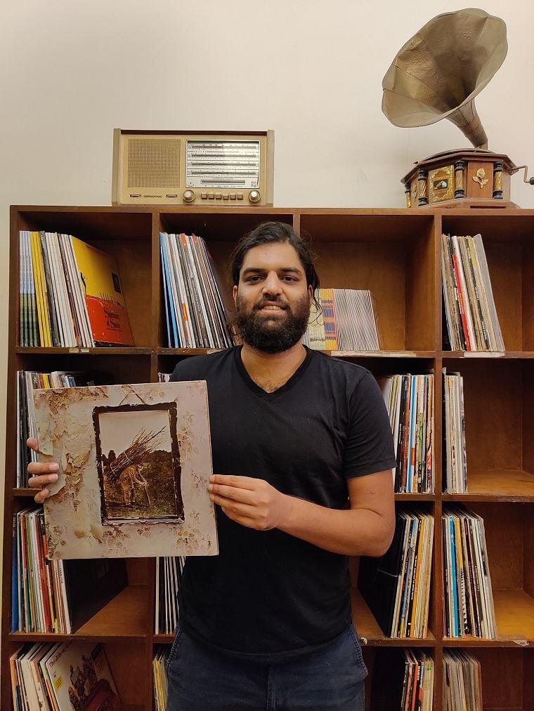 Jude de Souza Founder and CEO of The Revolver Club  with a Led Zepplin album