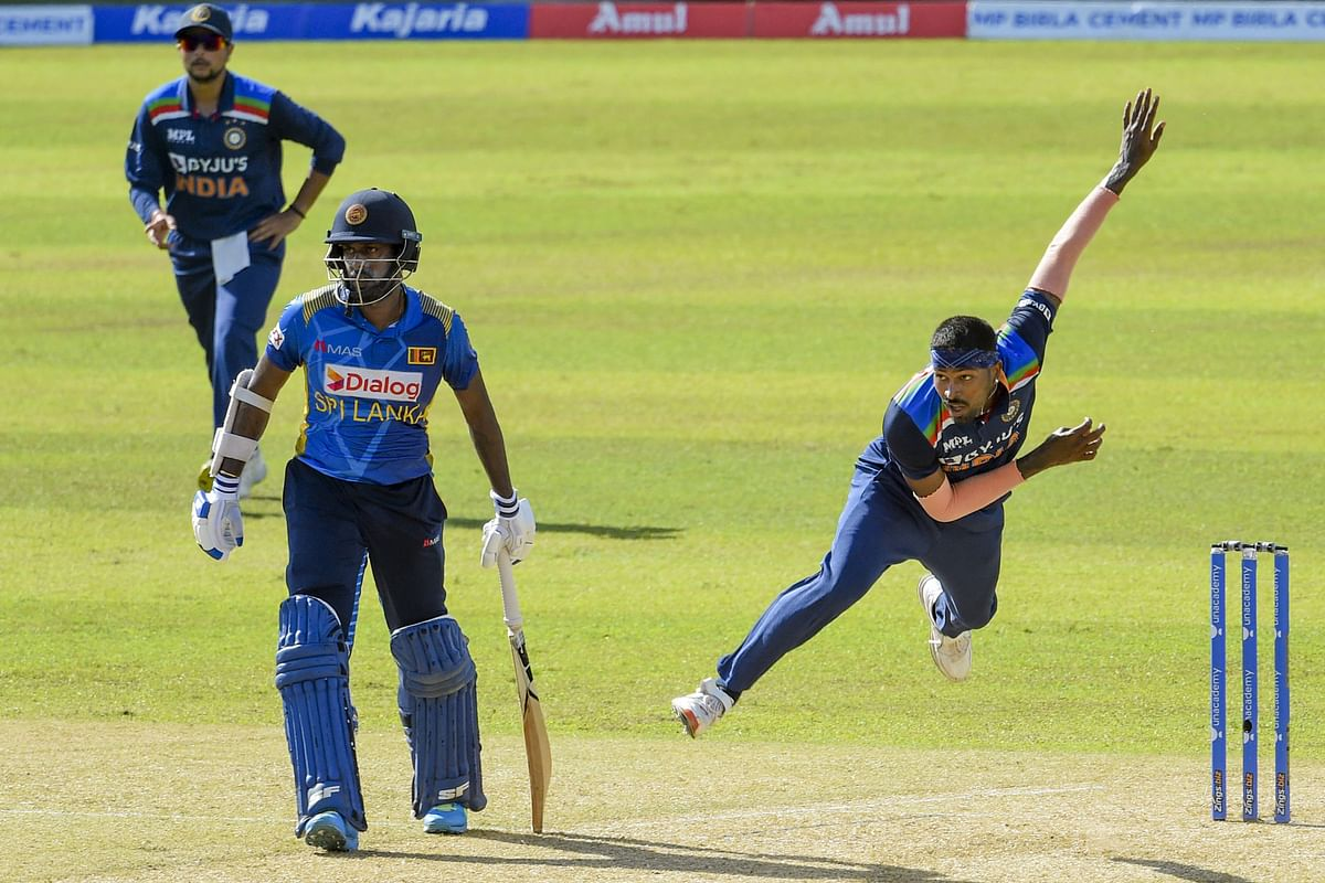 India's Hardik Pandya (R) delivers a ball during the second one-day international (ODI) cricket match between Sri Lanka and India at the R.Premadasa Stadium in Colombo on July 20, 2021. Photo by Ishara S. KODIKARA / AFP