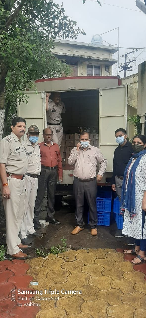 Officials with the seized liquor