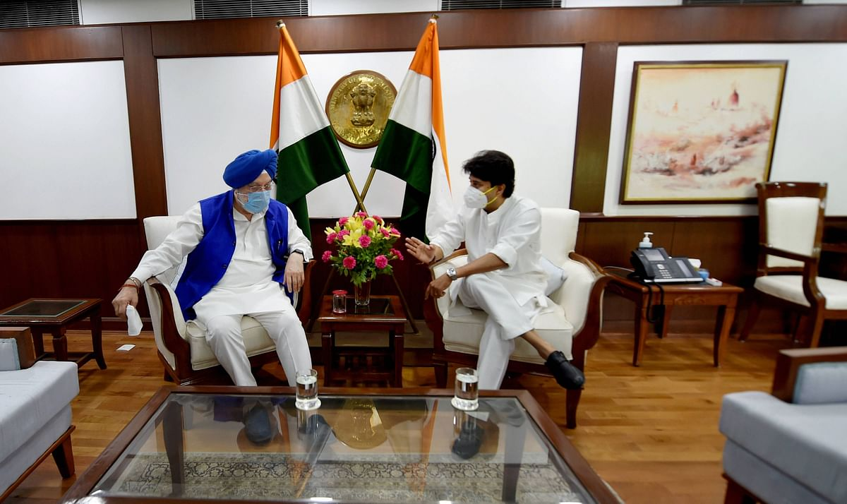 New Delhi: Union Civil Aviation Minister Jyotiraditya Scindia talks with Union Minister Hardeep Singh Puri while assuming office, in New Delhi on Friday