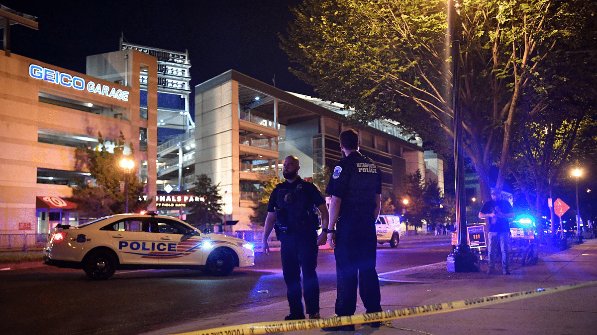 Police officers patrol a street near the Nationals Park stadium as the game between the Washington Nationals and the San Diego Padres was suspended due to a shooting outside the ballpark in Washington, DC, on July 17, 2021.