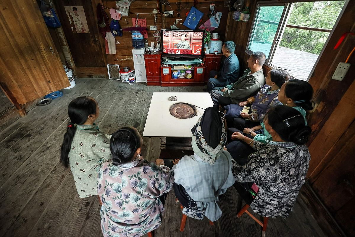 People of the Shui ethnic minority watch the celebrations to mark the 100th anniversary of the founding of the Communist Party of China in Danzhai, in Chinas southwestern Guizhou province on July 1, 2021.