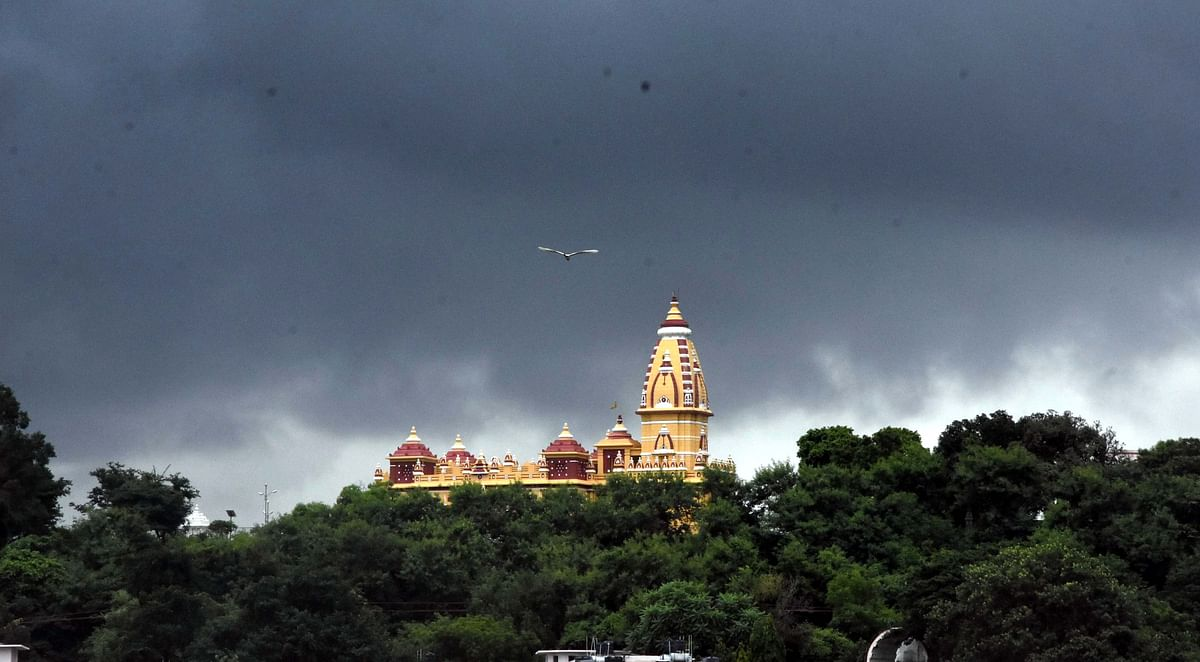 Nature's glory:  Birla Temple in Bhopal stands against the backdrop of dark sky and green earth.