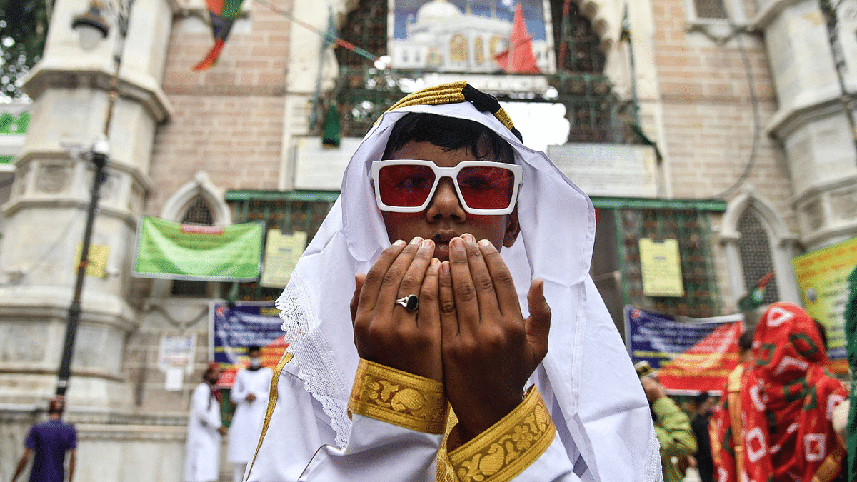 A young Muslim devotee offers prayers during the Eid al-Adha or the Festival of Sacrifice, in Ajmer on July 21, 2021.