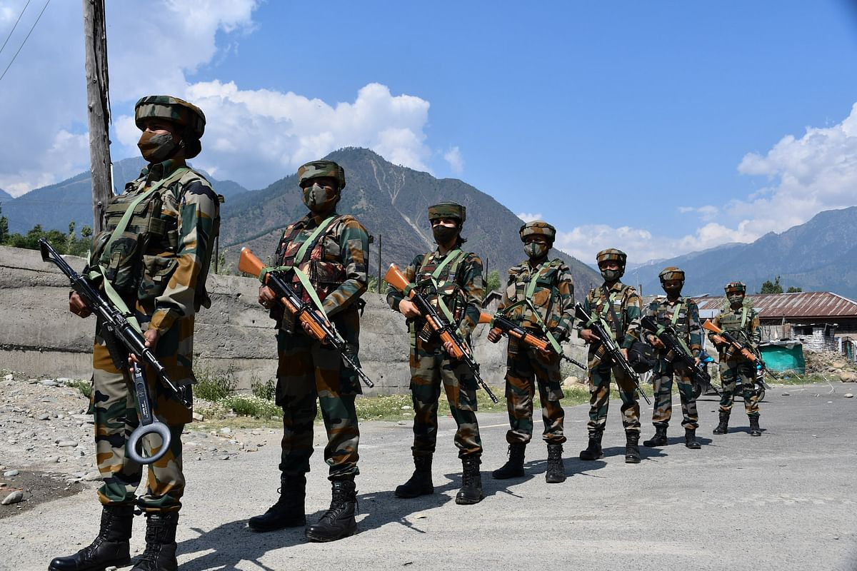 The soldiers guard  a checkpoint in Wasun area of Ganderbal district of Kashmir
