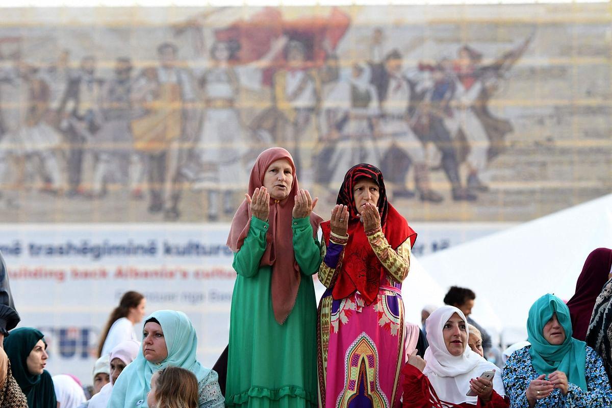 Albanian Muslim women pray during the Eid Al-Adha prayer at Skenderbej Square in Tirana on July 20, 2021.