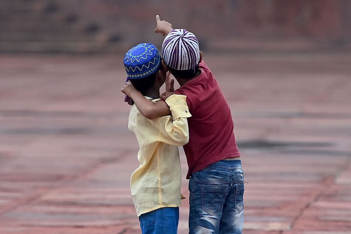 Children play after offering prayers during the Eid al-Adha festival, the feast of sacrifice at the Jama Masjid in New Delhi on July 21, 2021.