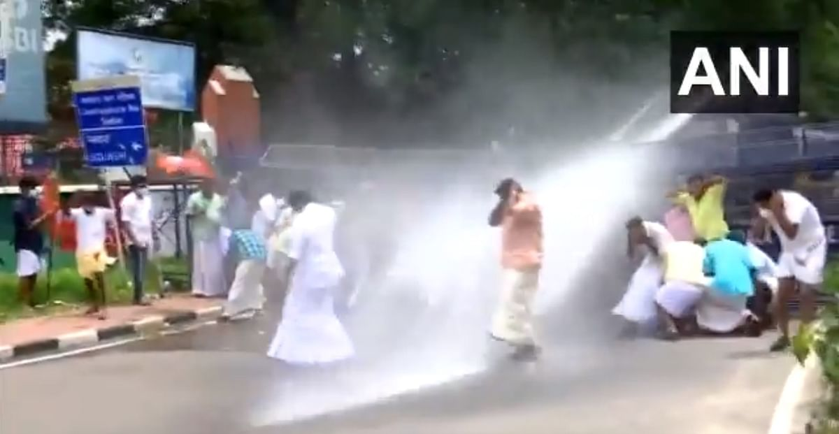 Watch: Kerala Police uses water cannons, fires tear gas to disperse BJP Yuva Morcha workers demanding resignation of minister AK Saseendran