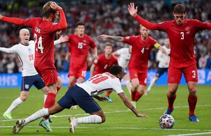 England's striker Raheem Sterling (Centre)  falls down