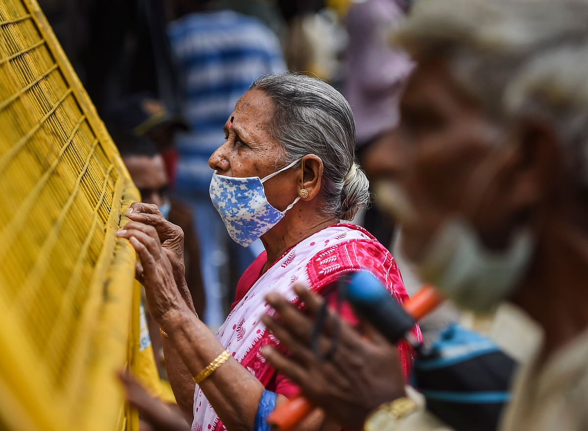 Mumbai: Devotees pay obeisance outside Lord Vithal-Rukmini Temple on the occasion of Ashadi Ekadashi as temples are still closed following Covid-19 protocols, at Dadar in Mumbai, Tuesday, July 20, 2021.