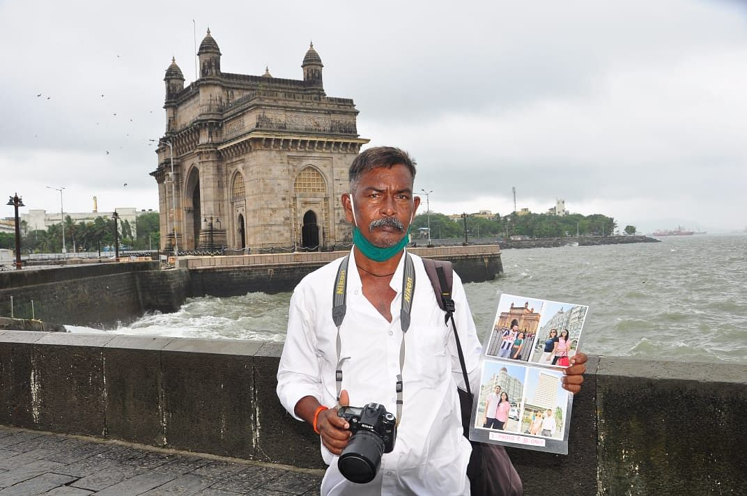 Mumbai: Meet Gulabchand Goad, 57-year-old photographer who saved woman from drowning Gateway of India