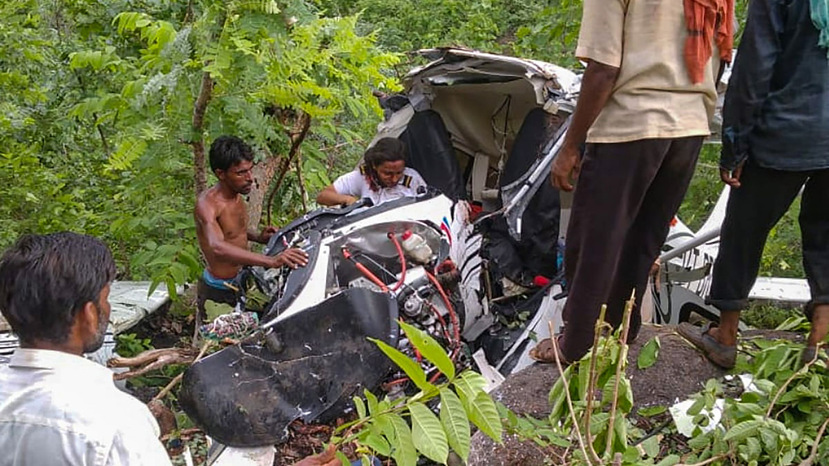 Jalgaon: Locals gather near the site after a helicopter crashed in Jalgaon district, Friday, July 16, 2021. A pilot died and another was injured in the accident.
