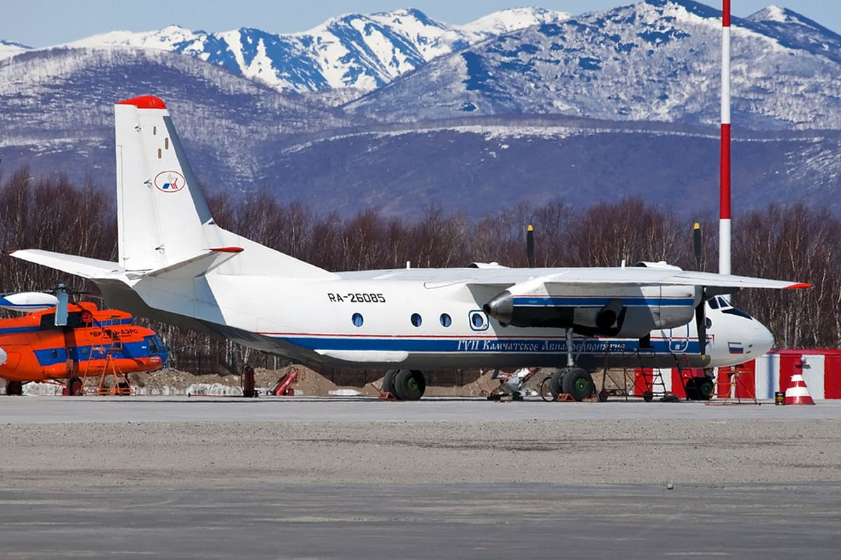 This handout photograph released by the Russian Emergency Situations Ministry on July 6, 2021, shows Russian An-26 aircraft with the tail number RA-26085 on the apron at the airport of Patropavlovsk-Kamchatckiy. - Contact has been lost with a passenger plane carrying more than two dozen people in Russias Far Eastern peninsula of Kamchatka, local officials said July 6, 2021.