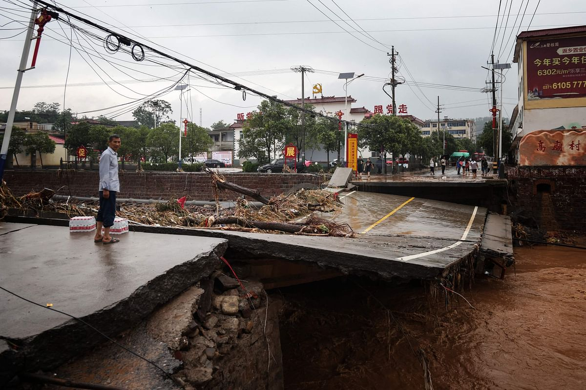 This photo taken on July 21, 2021 shows a damaged bridge following heavy rains which caused severe flooding in Gongyi in Chinas central Henan province.