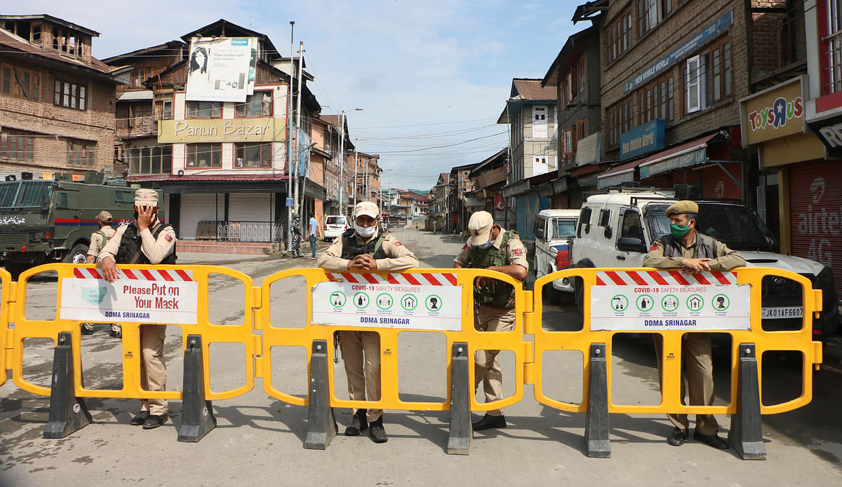 On Martyrs' Day 2021, policemen stand alert on a road in Srinagar that leads up to the martyr's graveyard. Martyrs' day is observed in Kashmir every year on 13th July to remember the 22 civilians who were killed in 1931.