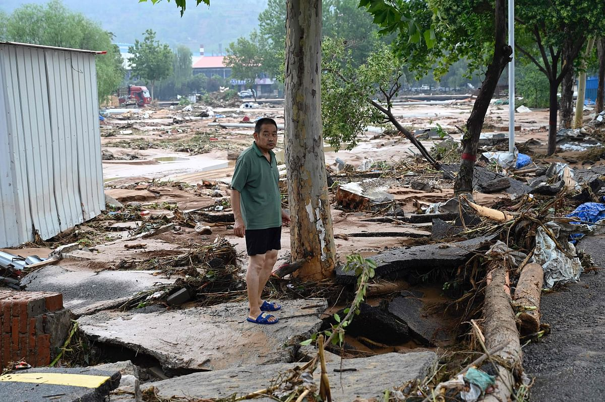 A resident stands on a flood-damaged site after severe flooding and landslide in recent days have hit the county-level Gongyi city, near Zhengzhou, in central China's Henan province on July 22, 2021.