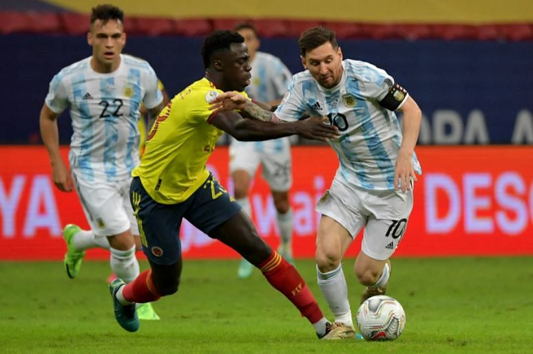 Argentina skipper Lionel Messi is challenged by Colombian defender