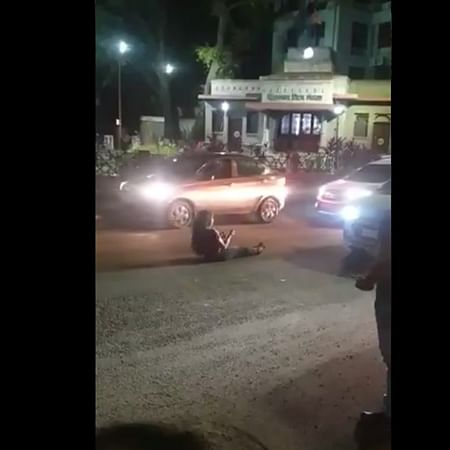 Watch: Intoxicated young woman rolls around on road amidst traffic at Pune's Hirabaug chowk; video goes viral