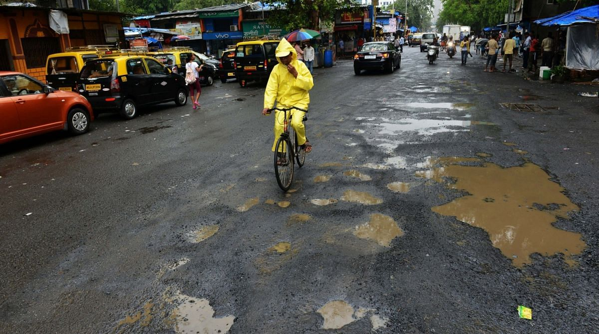 In Pics: Rains transform Mumbai roads into a lunar landscape; click here to see affected areas