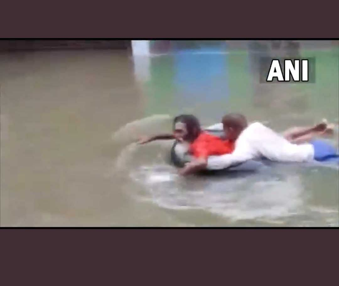 Watch Video: People swim through using tyres, vehicles stuck amid flooded roads in UP's Jhansi following incessant rains