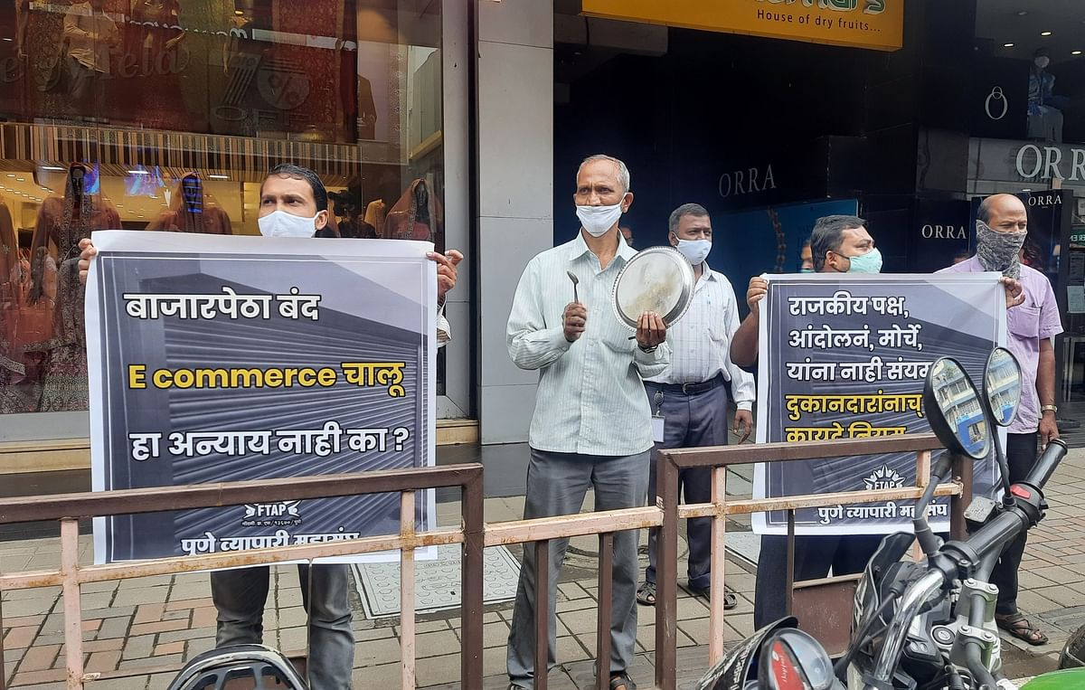 COVID-19: Pune traders protest against state government's decision of not allowing extended time for shops in city - Watch video