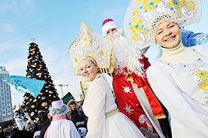 A little boy  poses for photos with a Christmas tree in the Taipei.  RIGHT: Men wearing  costumes of Ded Moroz (Grandfather Frost), the Santa Claus in Russia, Belarus and Ukraine, and women wearing costumes of Snegurochka  (Snow Maiden), the traditional companion of Ded Moroz, smile during their parade in Minsk.