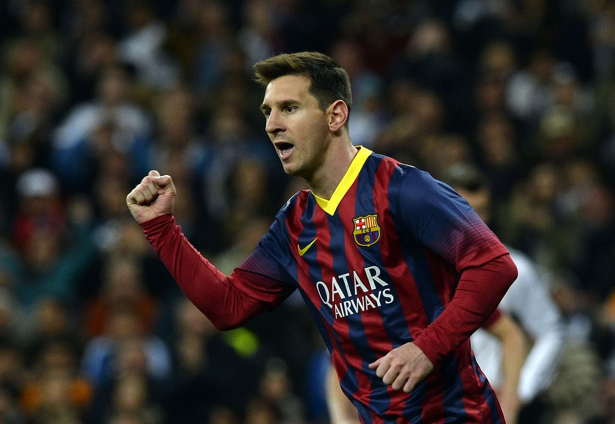 Messi hat-trick sees  Barcelona past Real