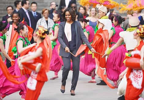 Michelle Obama (C) dances with traditional Chinese performers on the City Wall in Xian in China's central Shaanxi  province on Monday.  The First Lady took an indirect swipe at China's media censorship while speaking to students about the virtues of free speech at Peking University on Saturday.