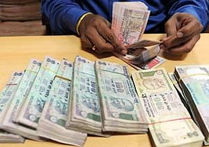 Rupee up 7 paise against dollar in early trade