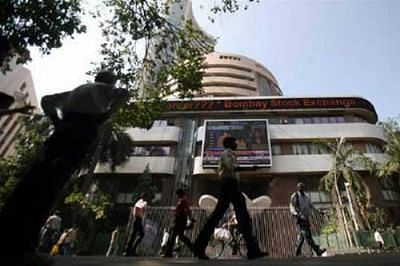 Sensex, Nifty give up most gains after initial surge, end flat