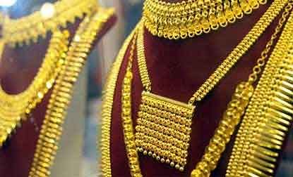 Gold down in futures trade on global cues, rising rupee