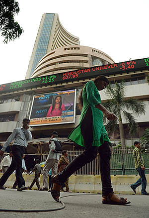 Sensex, Nifty end at new closing peaks ahead of poll results