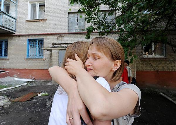 Women react in the Ukrainian city of Slavyansk after a night of combat between pro-Russia separatists with Ukrainian troops.