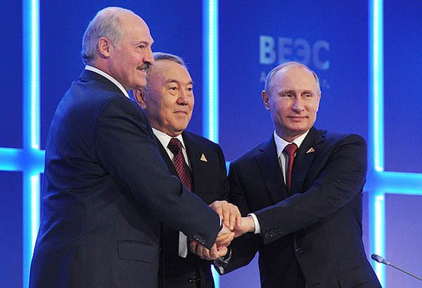 (From R) President Putin shakes hands with his Kazakh counterpart Nursultan Nazarbayev and Belarussian counterpart Alexander Lukashenko during a meeting  of the Supreme Eurasian Economic Council in Astana. Kyrgyzstan and Armenia may also  join the union.
