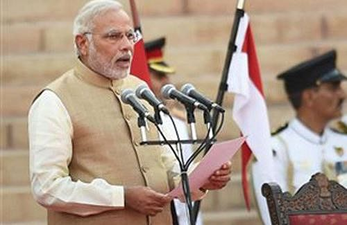 Narendra Modi takes charge as PM