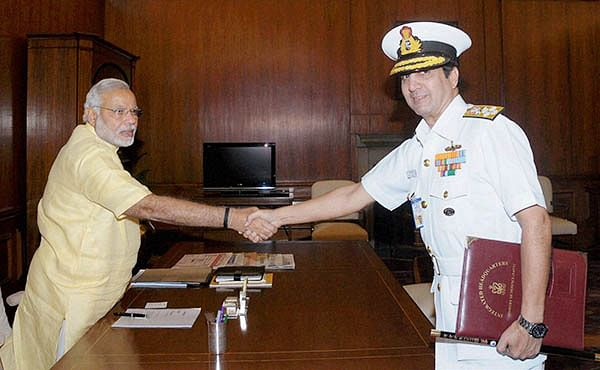 PM Narendra Modi with Chief of Naval Staff, Admiral R K Dhowan at South Block in New Delhi on Thursday.