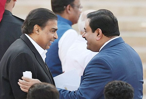 Industrialists Mukesh Ambani and Gautam Adani/file