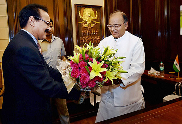 Finance Secretary Arvind Mayaram presents a bouquet to Arun Jaitley as he takes charge as Finance Minister at his office in New Delhi on Tuesday.
