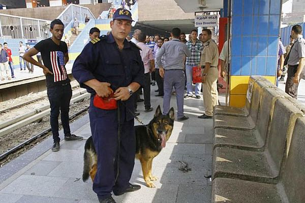 Egyptian Forces inspect damage after an explosion hit a subway station in Cairo.
