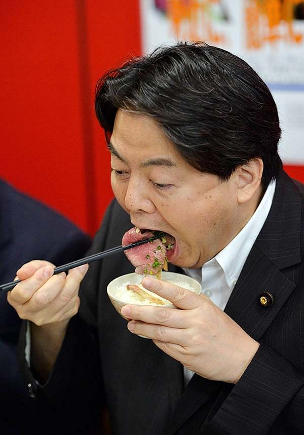 Japanese Minister  Yoshimasa Hayashi eats whale meat for promotion to eat whale meat at his ministry in Tokyo.