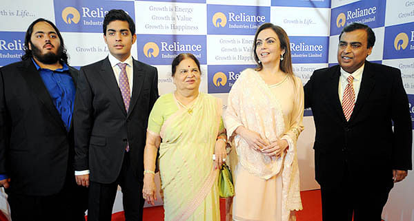 Industrialist Mukesh Ambani along with wife Nita Ambani (second from Right), mother Kokilaben (C) and sons arrive at the 40th annual meeting of Reliance Industries in Mumbai on Wednesday.  Shareholders approved appointmentof Nita Ambani to the board of  directors,  making her the first woman ever on the company's board.
