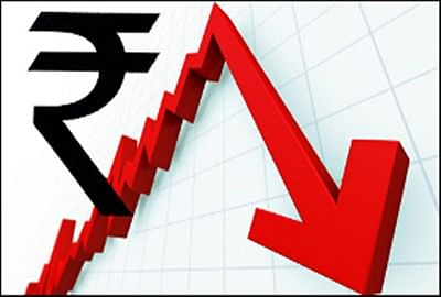 Rupee slumps to hit a new low of 76.91 a dollar