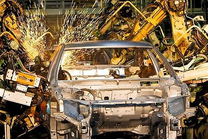 Manufacturing output shrinks for 1st time in over 2 years