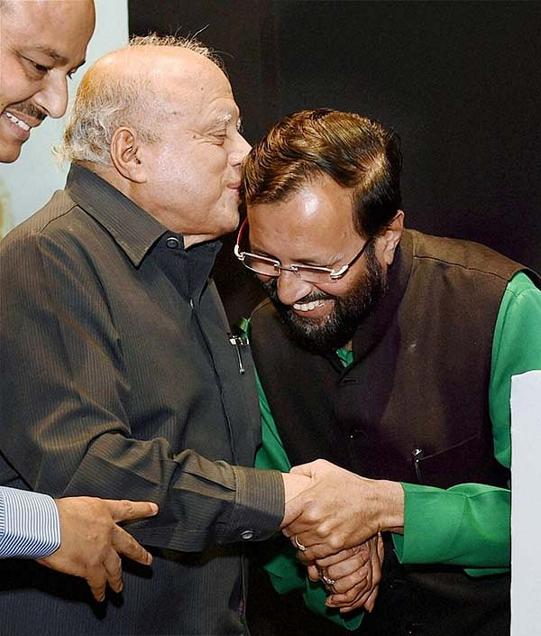 Environment Minister Prakash Javadekar greets  Agriculture scientist M S Swaminathan during a World Environment Day function in New Delhi on Thursday.