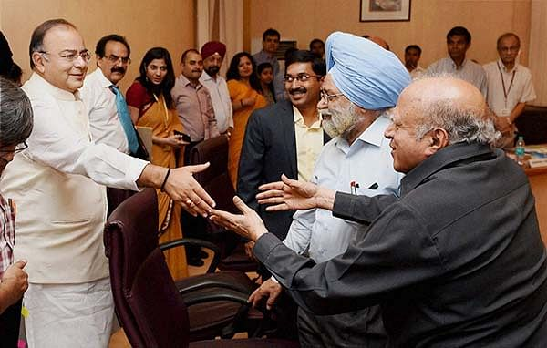 Finance Minister Arun Jaitley shakes hand with  Agriculture scientist MS Swaminathan during the  pre-budget consultations with representatives of  Agriculture Sector in connection with the forthcoming Union Budget 2014-15 in New Delhi on Thursday.