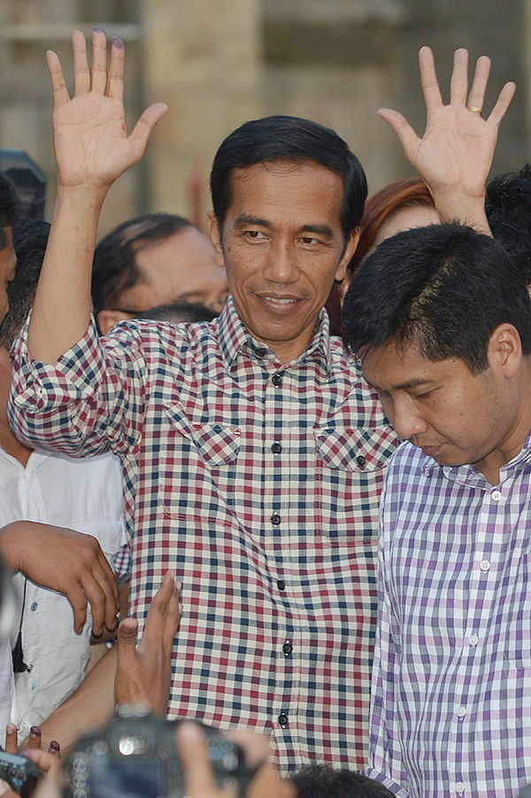 Indonesian presidential candidate Joko Widodo gestures to his supporters.